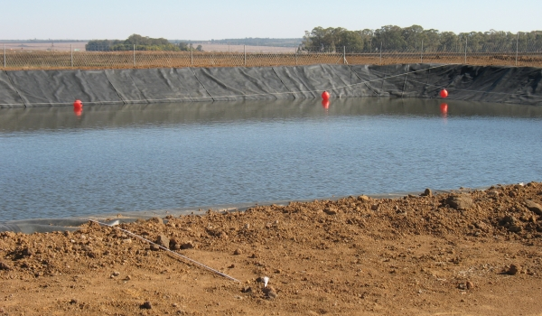 Lined pollution control dam